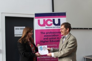 Sally Hunt presents UEA UCU President Tim Southon with a card to celebrate 50 years of UEA